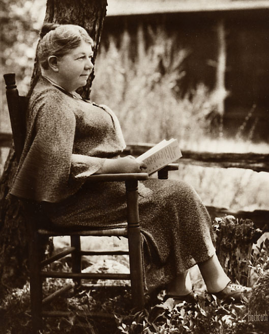 Sepia, 8×10, 1934. Seated holding a book. Photographer: Bachrach.